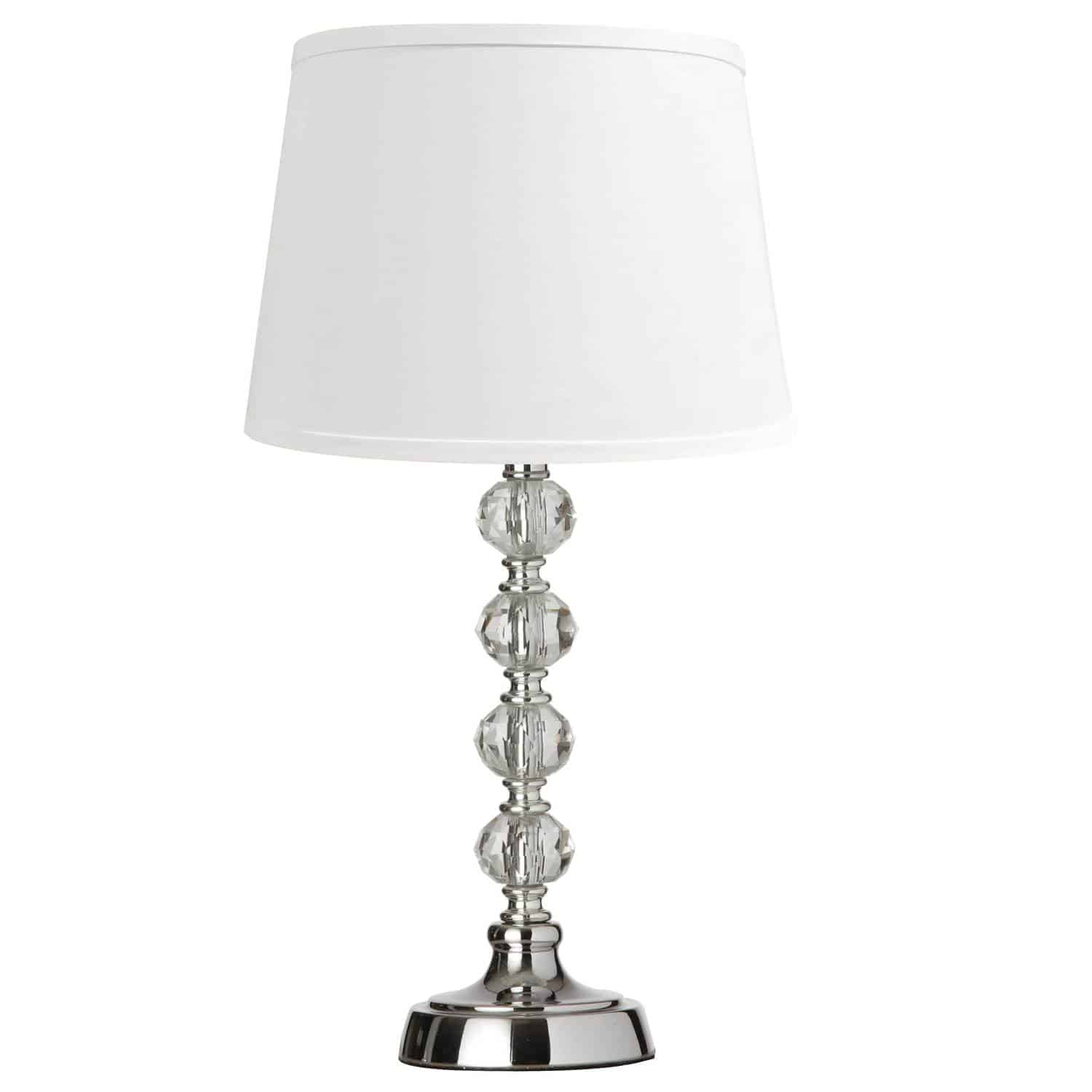 Optical crystal lamps combine a stylish geometric design with the shimmering sparkle of optical crystals for a look that won't go unnoticed.  Polished chrome stands and frames combine with clean white shades to create a classic look of contemporary elegance. Optical crystals are incorporated into the design to add a note of opulence that enhances the effect with a touch of yesteryear's grandeur.  Optical crystal lamps are available in tabletop and floor models that can be used throughout the home to create a unified effect with options that will blend with both traditional and modern furnishings.